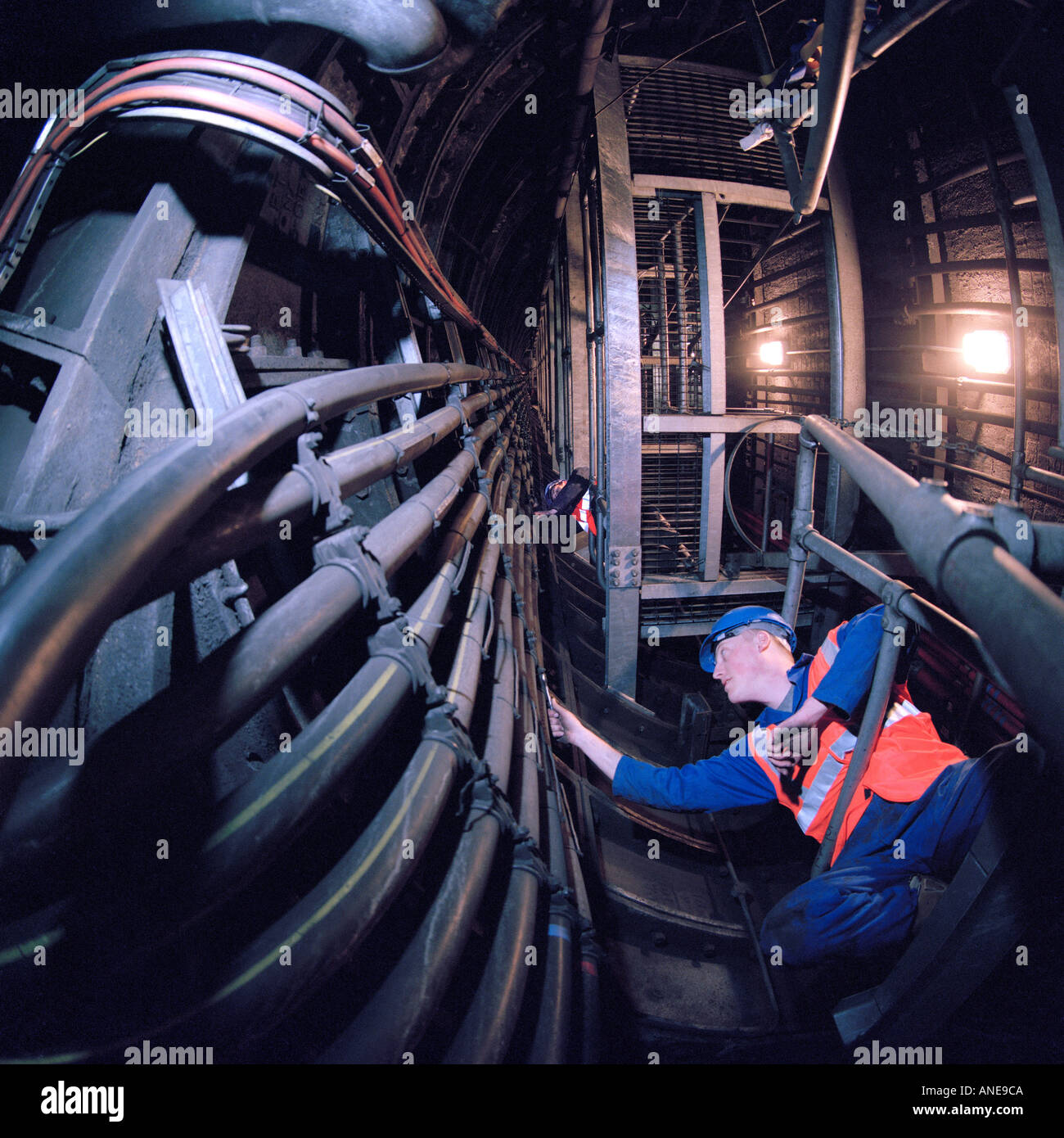 Electricians carrying out essential maintenance on power cables on the London Underground Network - Stock Image