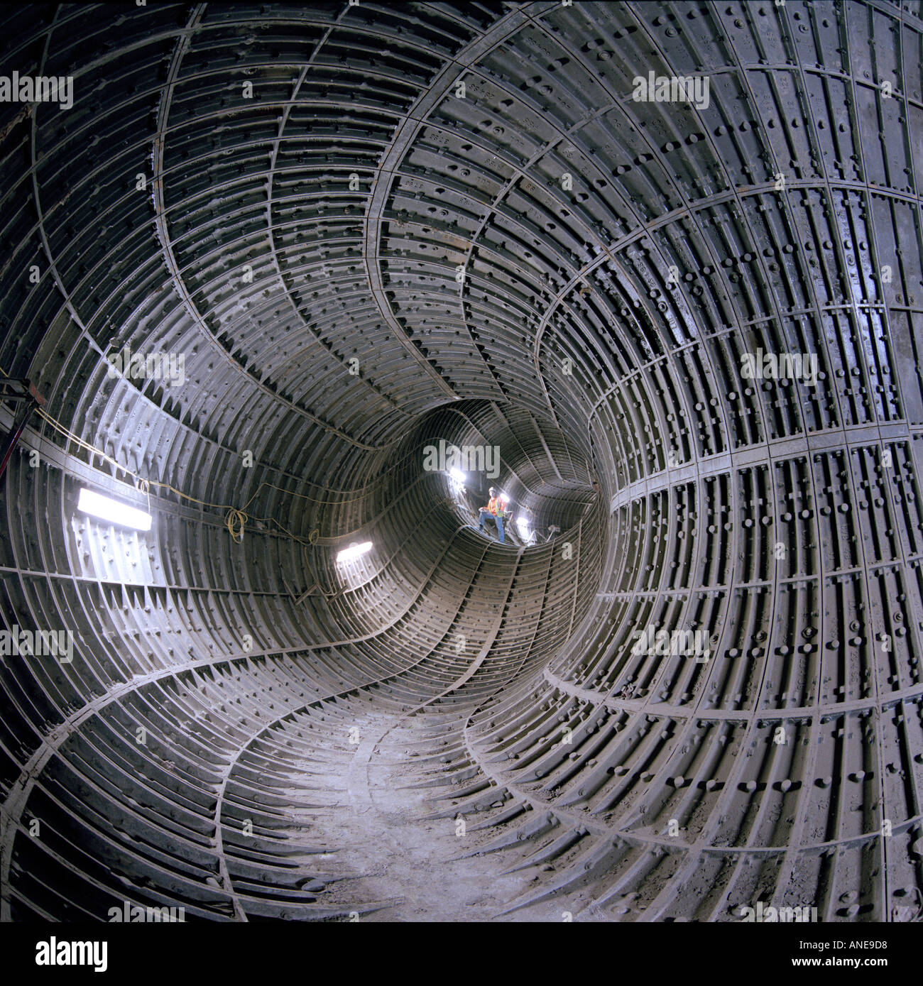Cast iron tunnel lining segments form a fascinating pattern in a ventilation shaft on the London Underground Network - Stock Image