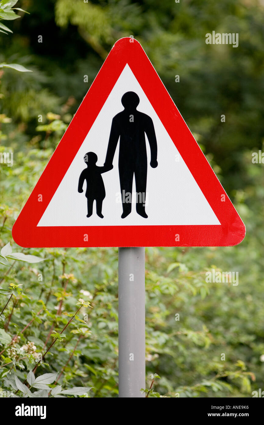 Pedestrians In Road Ahead warning sign by the road in Oxfordshire United Kingdom Stock Photo
