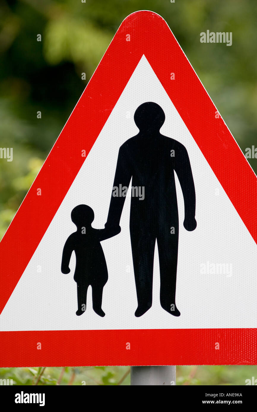Pedestrians In Road Ahead warning sign by the road in Oxfordshire United Kingdom - Stock Image