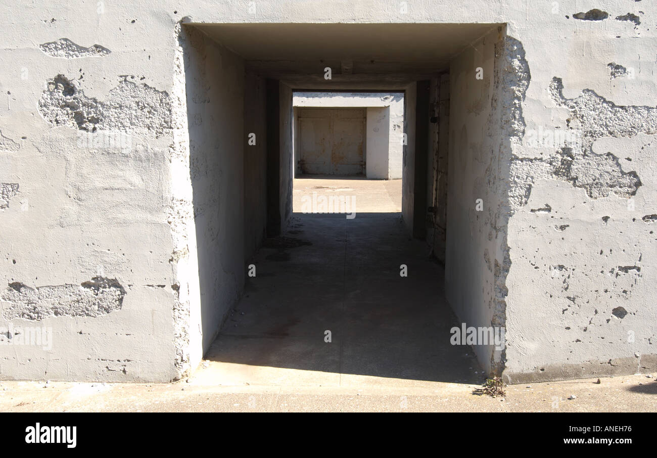 Concrete bunker passageway cement fortified protection hiding place surreptious - Stock Image
