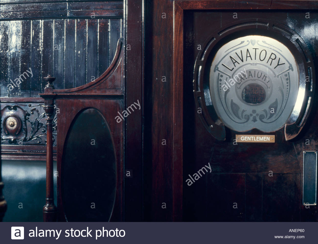 Entrance to Gents Lavatory, Horseshoe Bar, Drury Road, Glasgow, 1870s. Mahogany and etched glass. - Stock Image