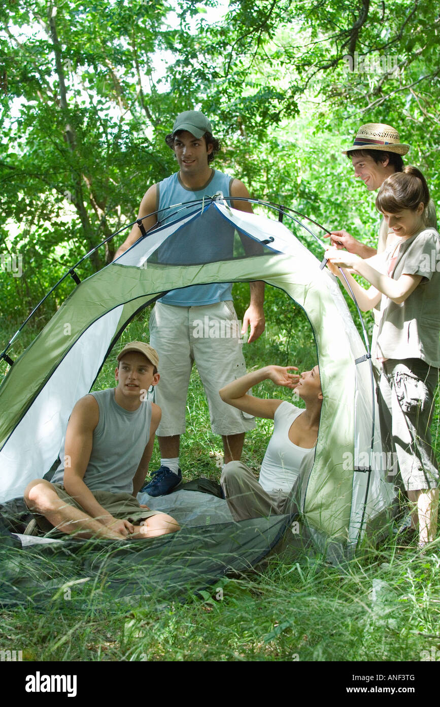 Young campers with tent - Stock Image