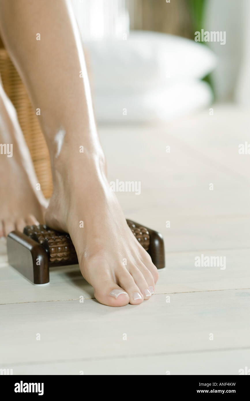Woman's foot on foot massager - Stock Image