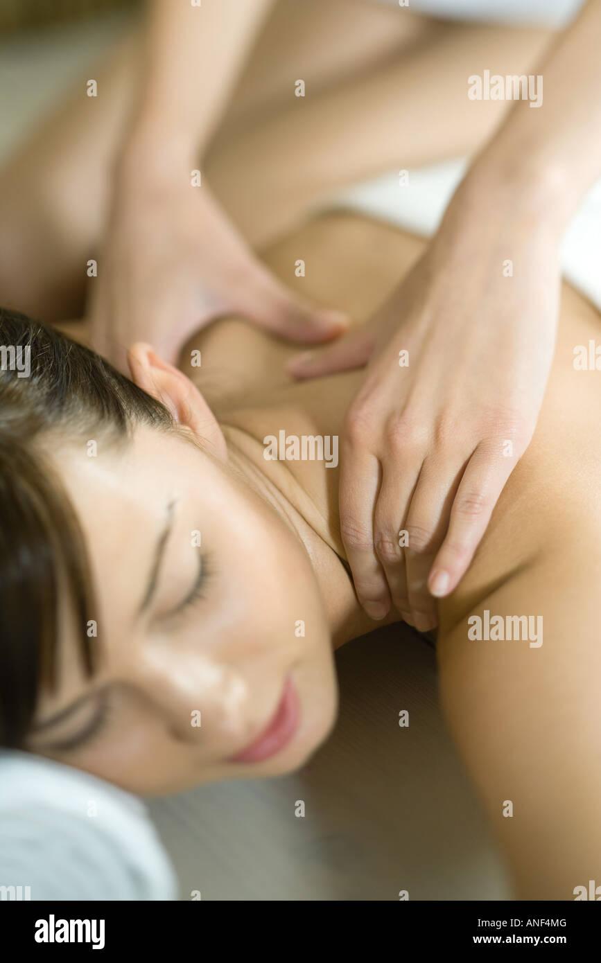 Woman having back massage, close-up - Stock Image