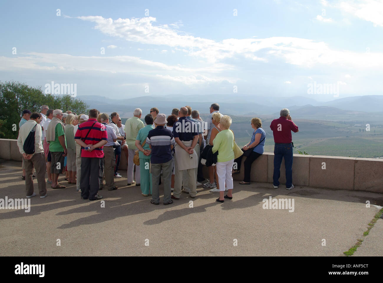 Sevastopol Sapun museum memorial complex tour group with guide at viewpoint which overlooks Battlefield of Balaklava - Stock Image