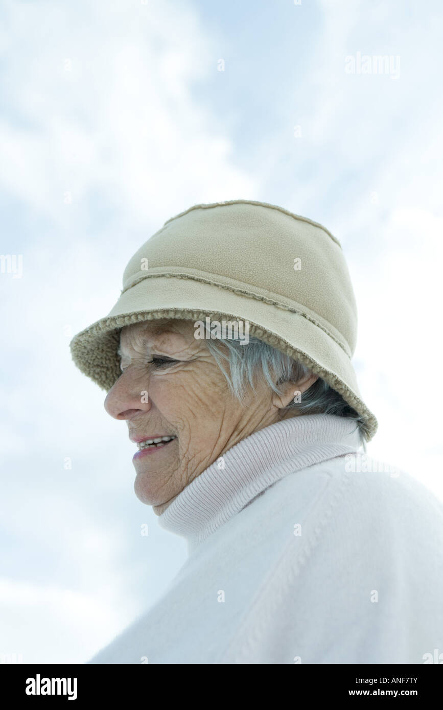 Senior woman wearing warm clothes, head and shoulders - Stock Image