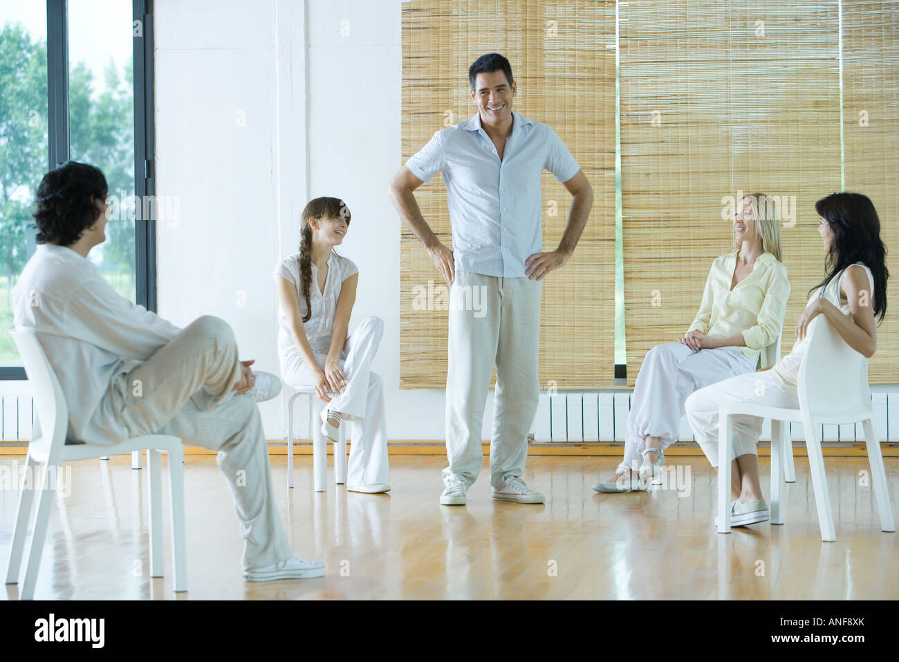 Man leading group therapy session - Stock Image