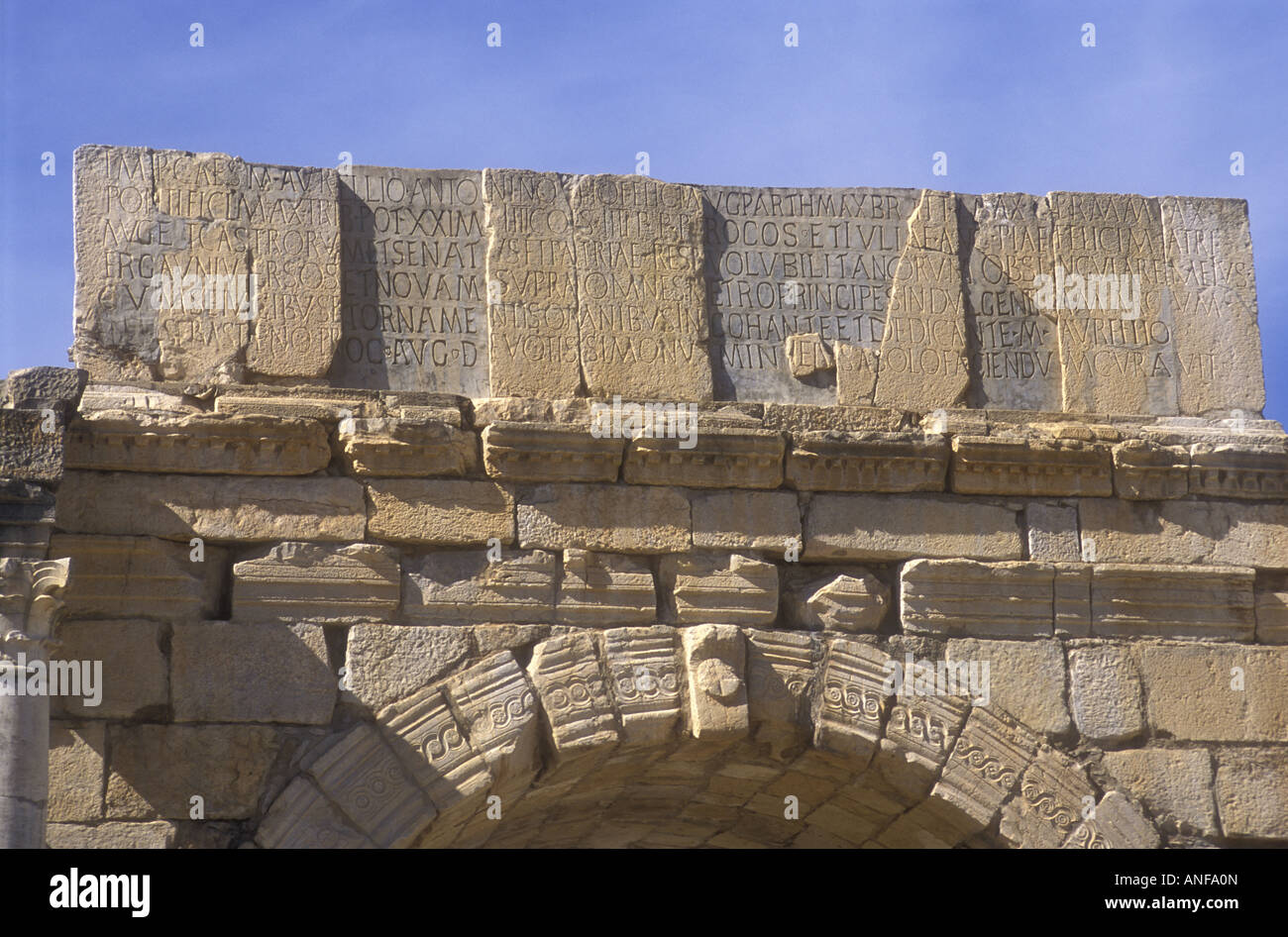 Latin Inscription obove the Triumphal Arch in the Roman ruins at Volubilis Morocco North Africa - Stock Image