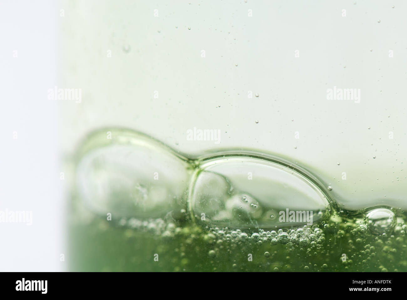 Bubbles in green gel, extreme close-up - Stock Image
