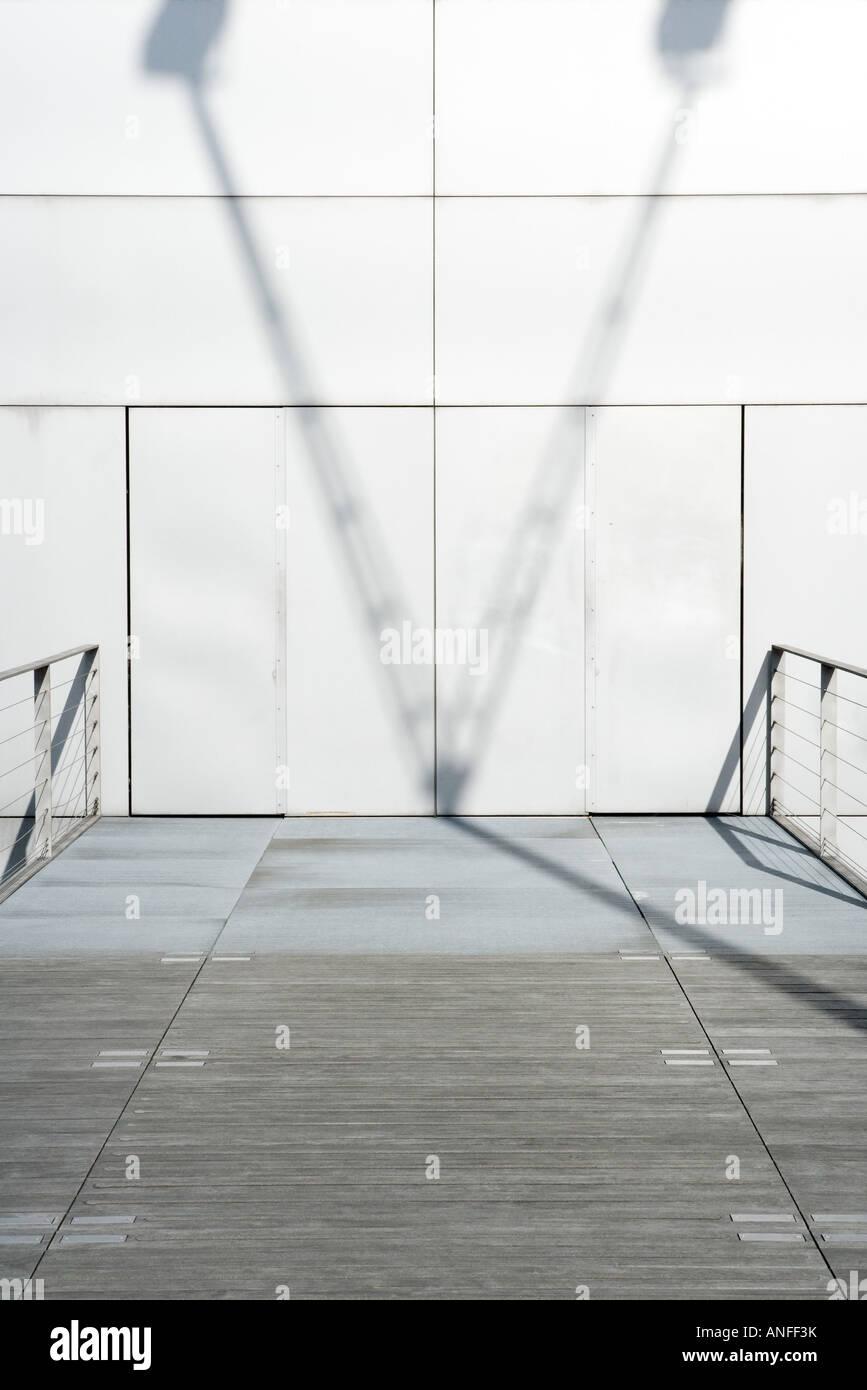 Shadow on wall and walkway - Stock Image