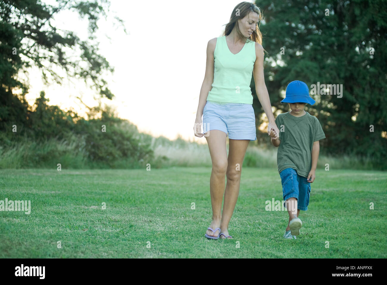 Mother and son, walking hand in hand - Stock Image