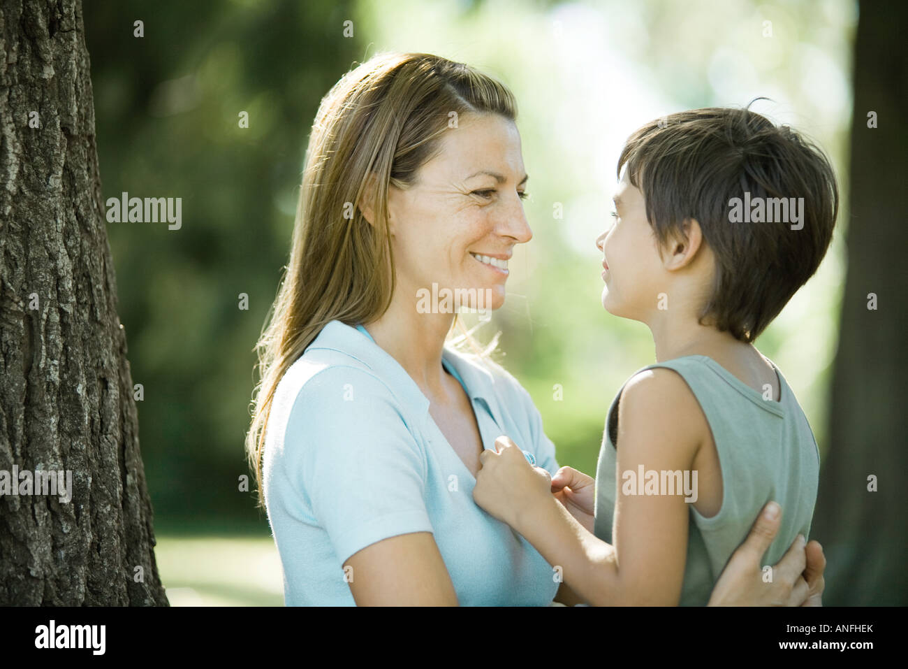 Mother and son outdoors, face to face - Stock Image