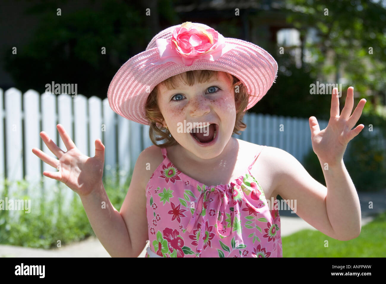 5 year old girl with sundress and hat showing surprise, canada. - Stock Image