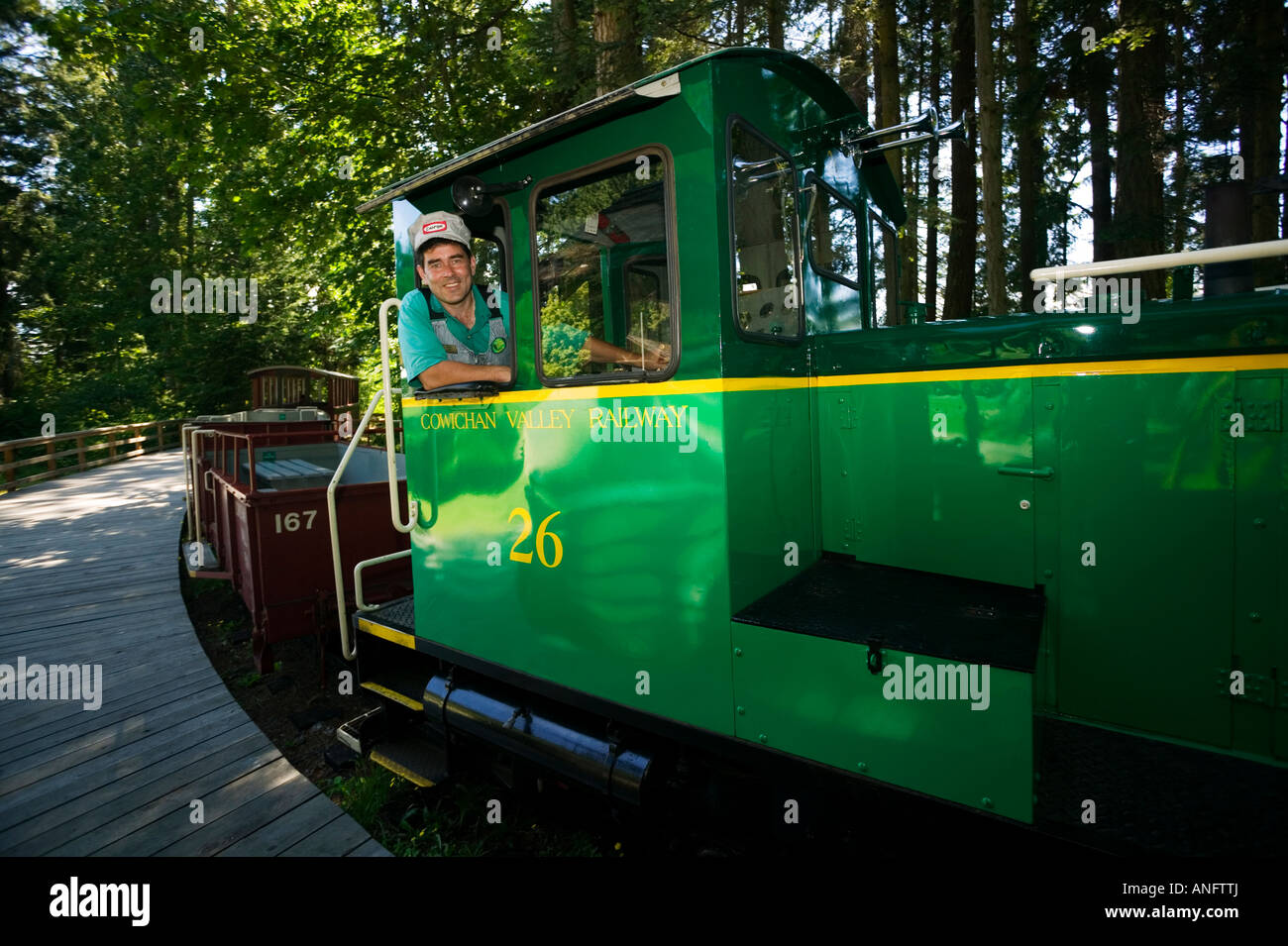Locomotive engineer at British Columbia Forestry Museum providing rides to tourists, Duncan, Vancouver Island, British - Stock Image