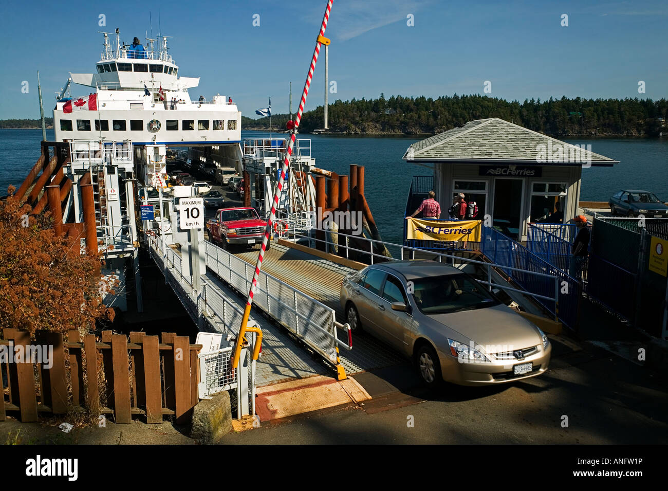 Cars unloading from BC Ferry at Lyall Harbour on Saturna Island, Saturna Island, British Columbia, Canada. - Stock Image