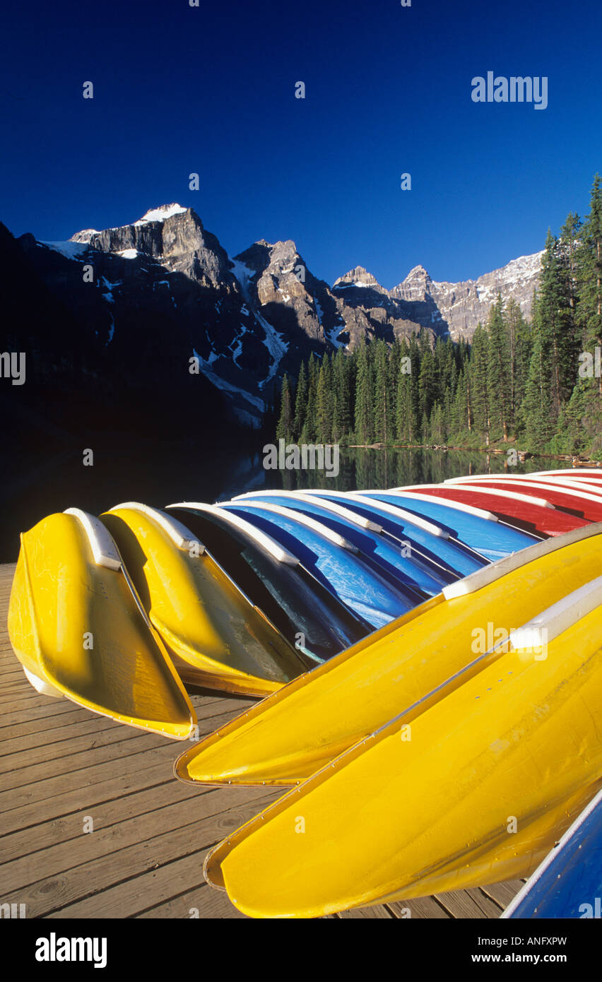 Canoes stacked on dock at Moraine Lake, Banff National Park, Alberta, Canada. - Stock Image