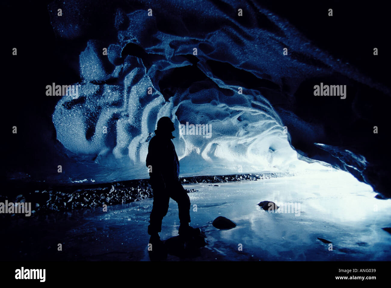 Male Hiker in Ice Cave Near Valdez SC Alaska Winter - Stock Image