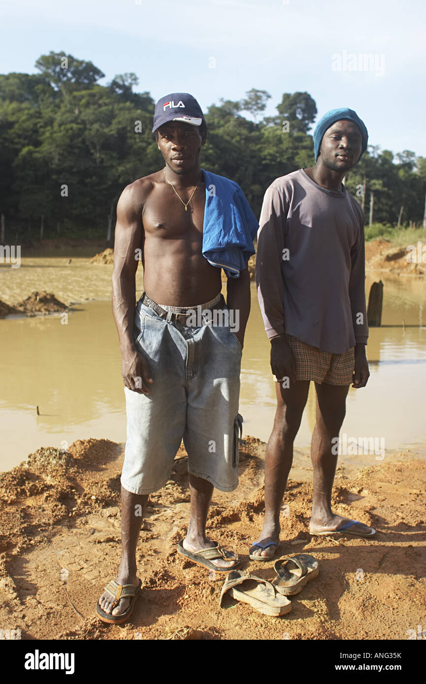 Workers at an unregulated gold mining operation on the Brokopondo reservoir Suriname - Stock Image