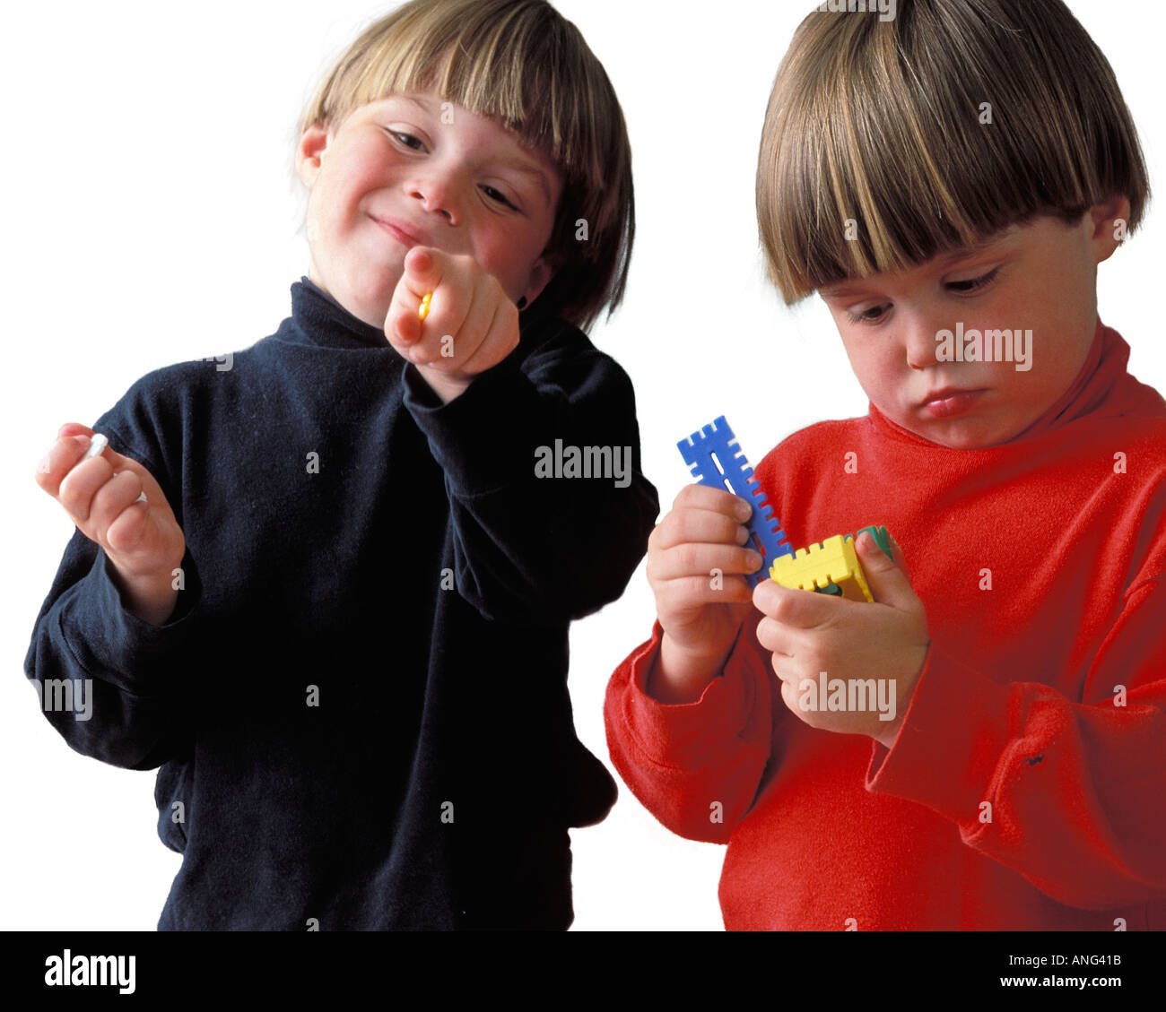 Portrait of two Caucasian twin Boys playing The white background - Stock Image