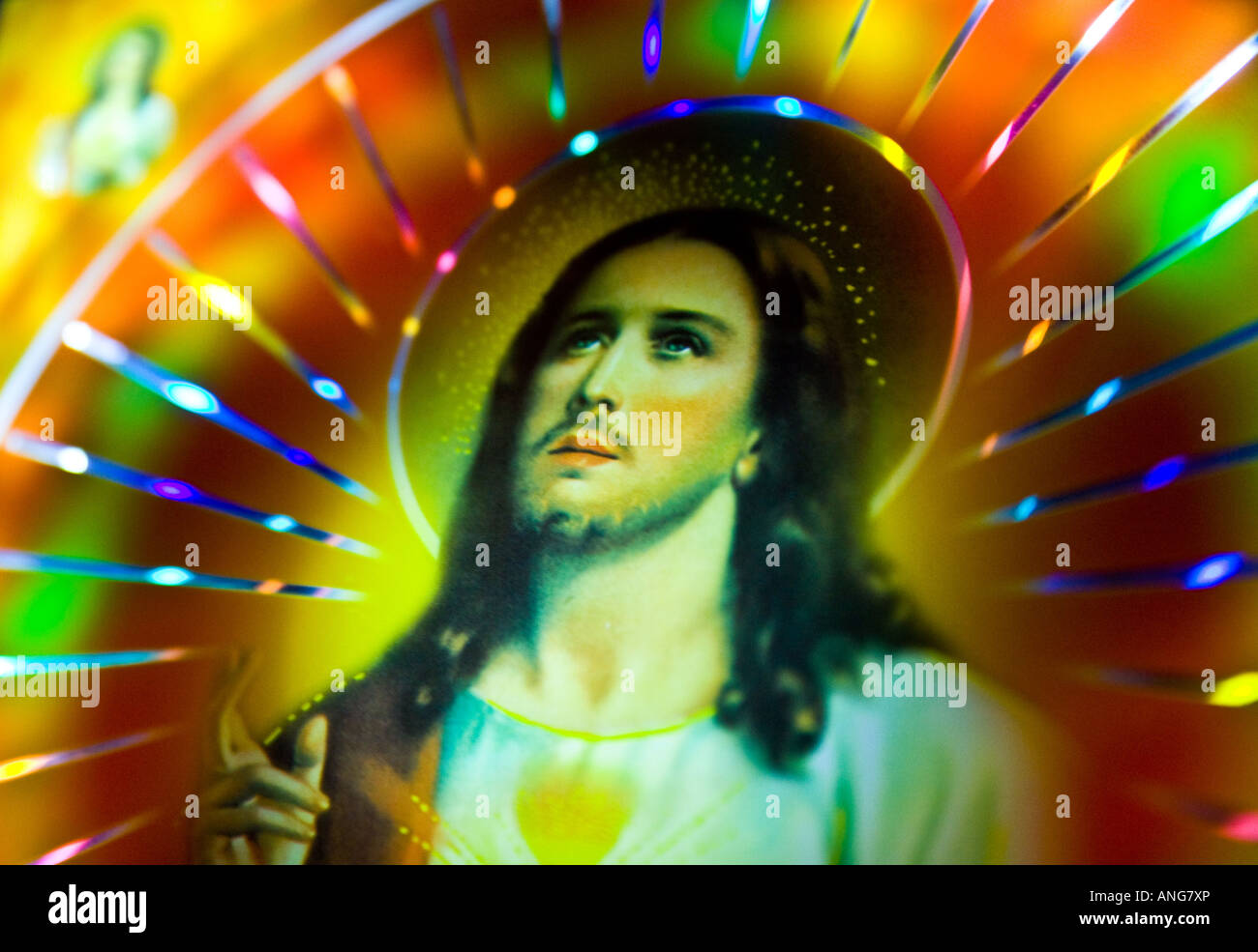 artwork of Jesus illuminated by colorful lights. - Stock Image