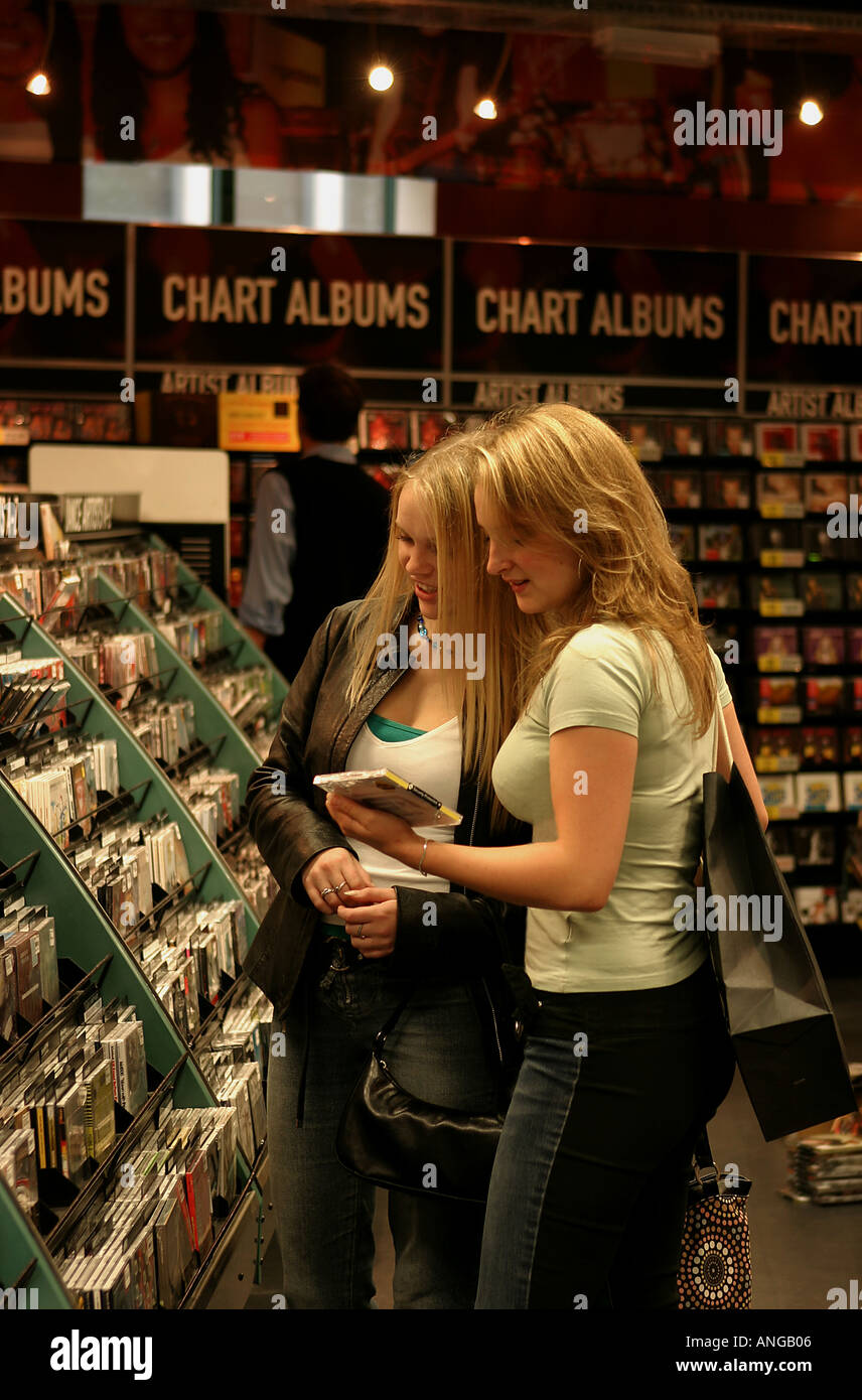 Young Women Buying CD s Cardiff City Centre South Wales - Stock Image