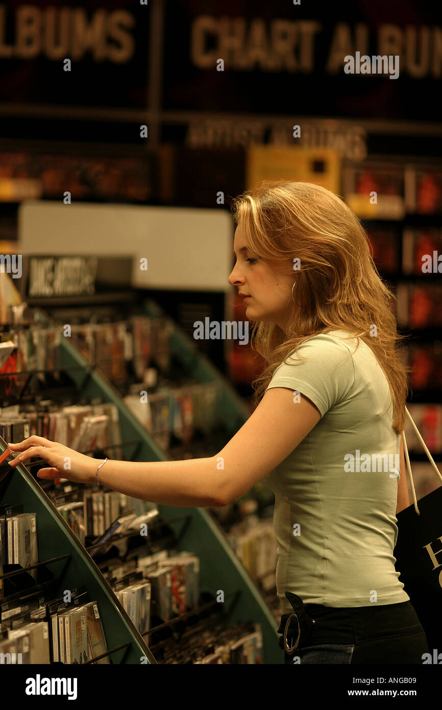 Young Woman Shopping for CD s Cardiff City Centre South Wales - Stock Image