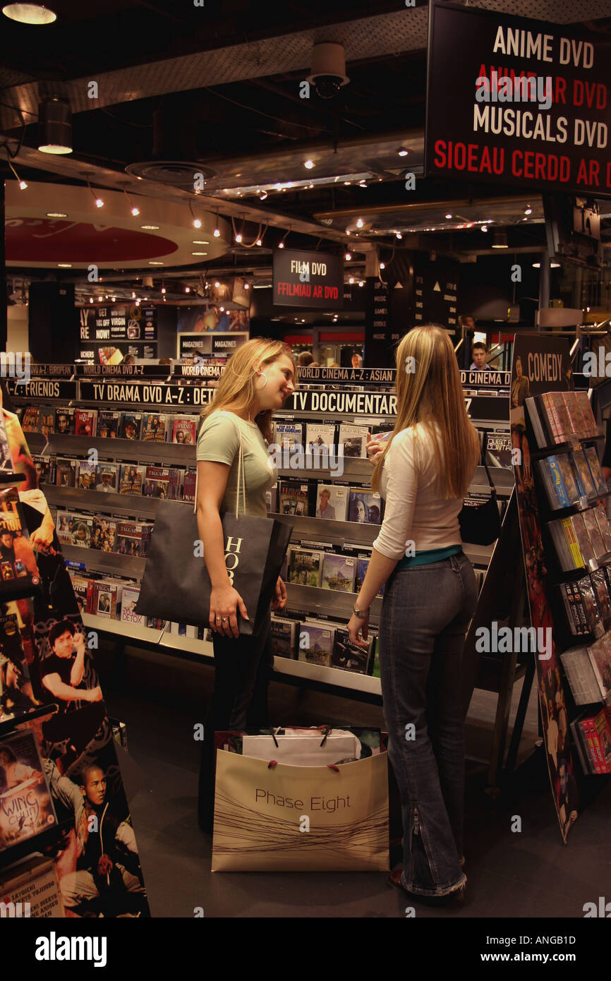 Young Women Shopping for CD s Cardiff City Centre South Wales - Stock Image