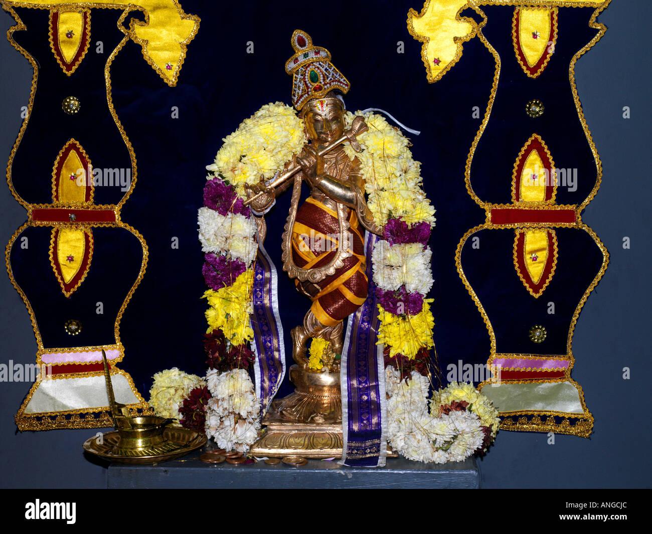 Murugan Tamil Temple New Malden Surrey England Lord Krishna and Offerings - Stock Image