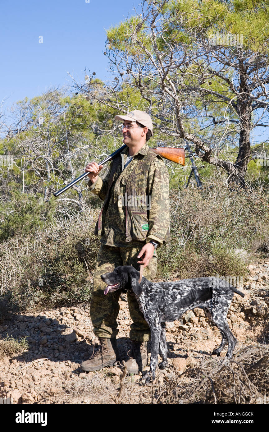 Cypriot Hunter spring migratory Bird Shooter with Shotgun in the Akamas Peninsula north-west of Pafos, Cyprus, Mediterranean. Stock Photo