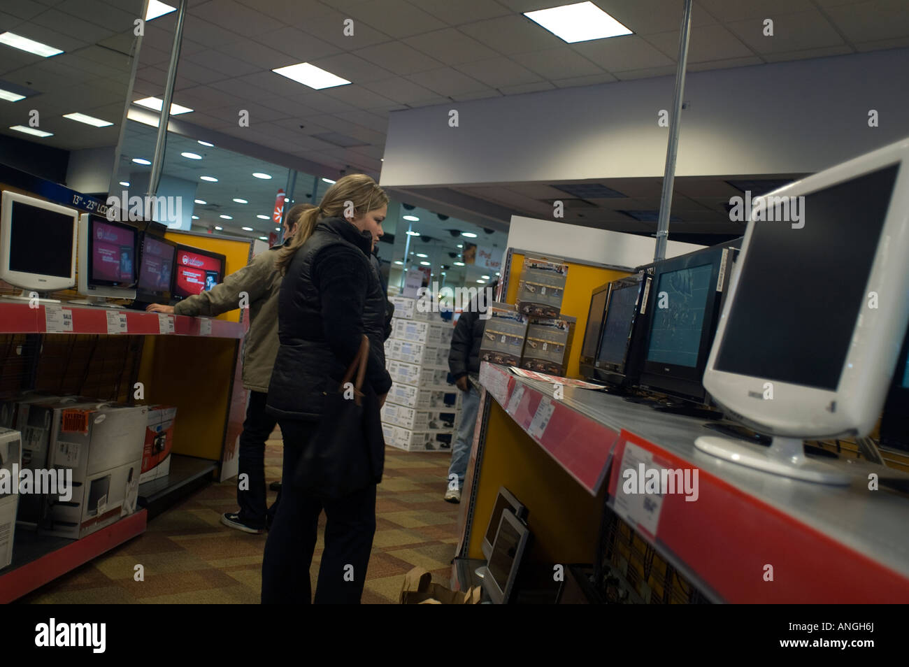 Customers browse in the television department at Circuit City electronics store - Stock Image