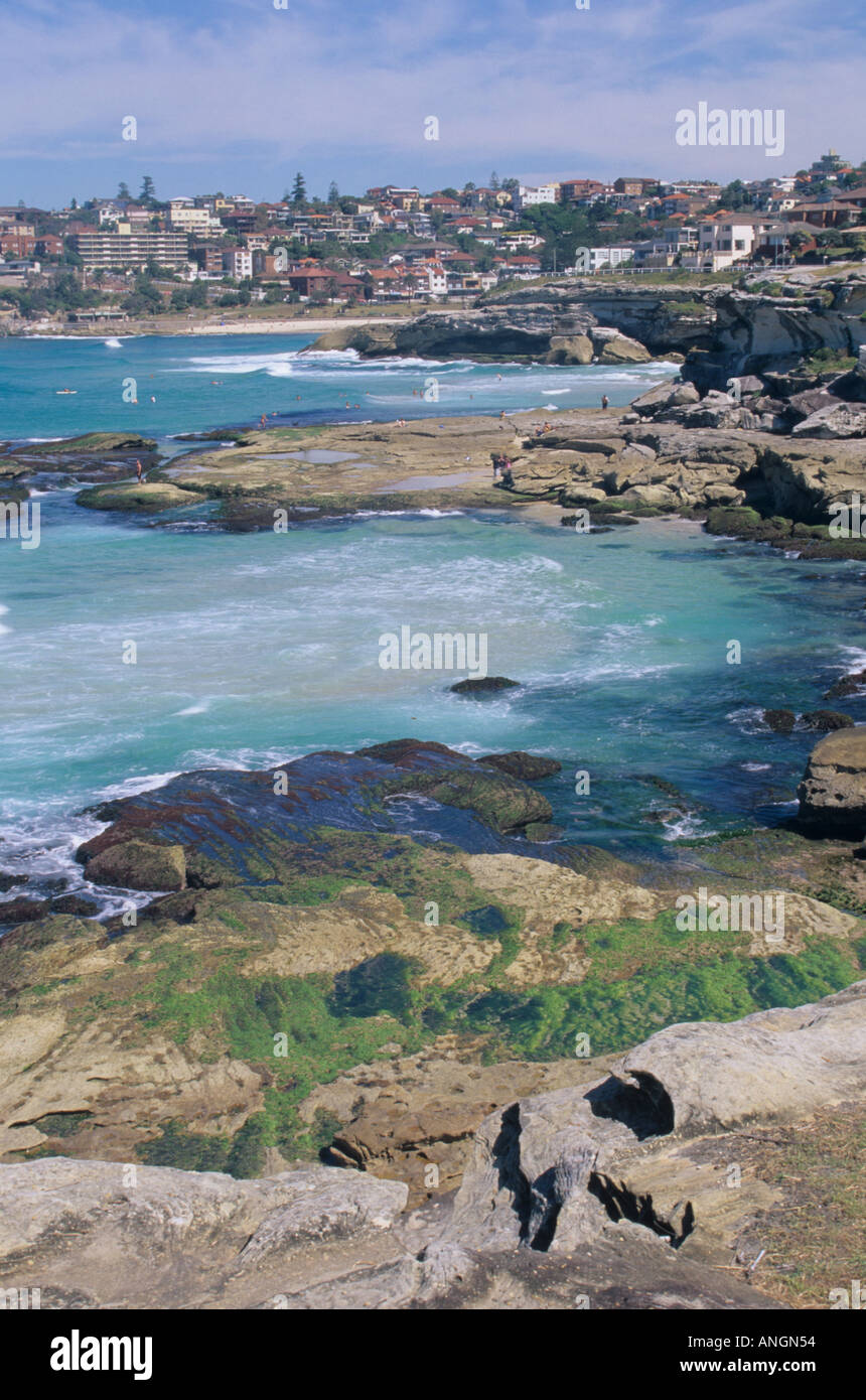 Bondi to Coogee famous costal walk, view of coves with town of Bronte in distance. Sydney NSW, Australia. Stock Photo