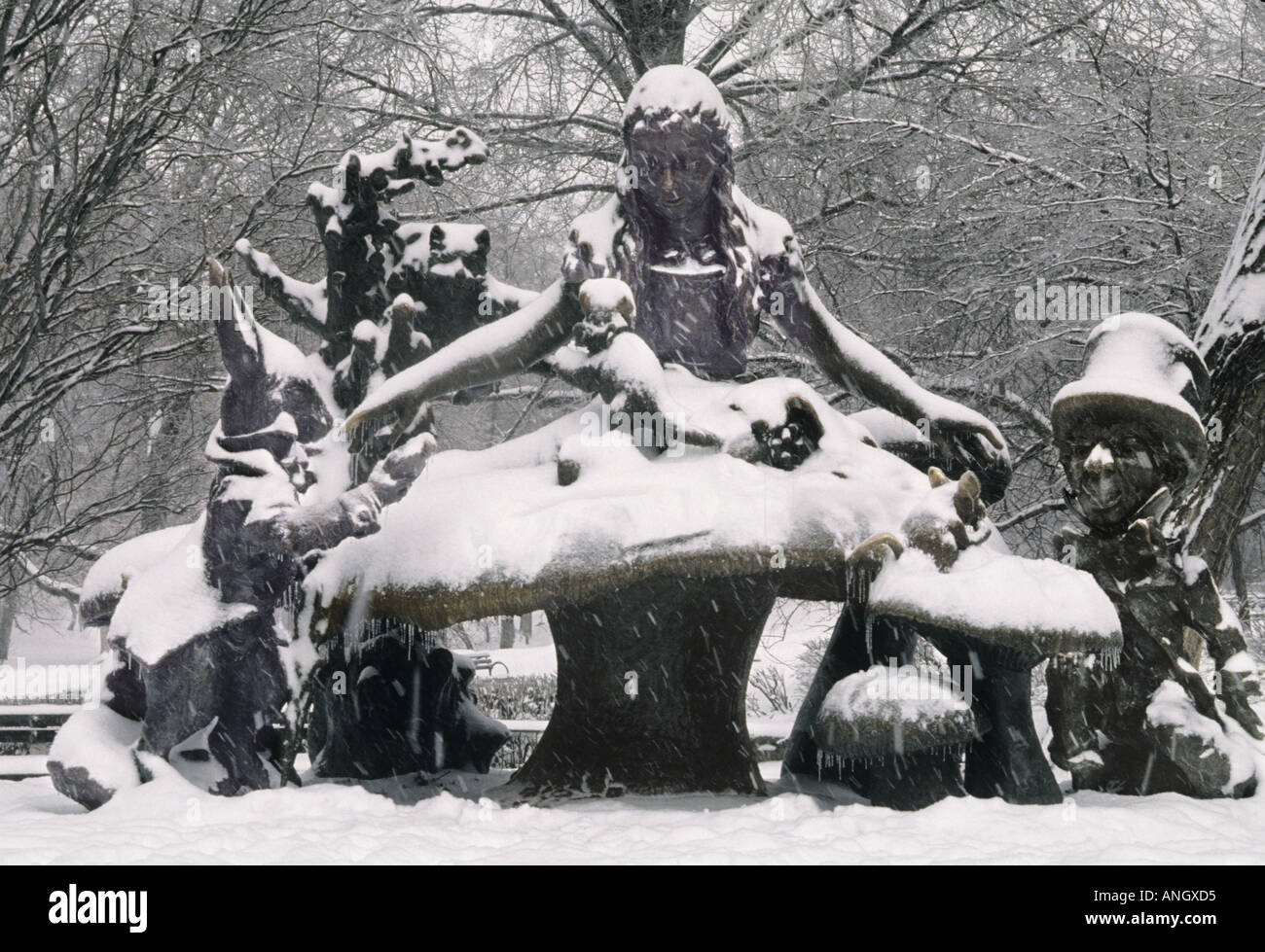 New York City Manhattan Central Park Statue of Alice in Wonderland on a Snowy Day - Stock Image
