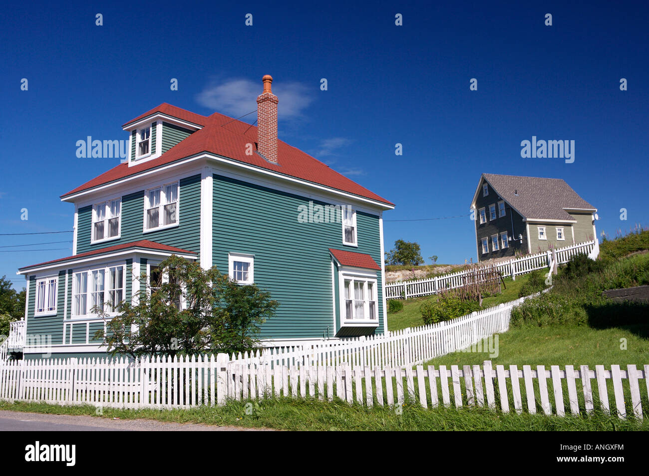 Houses with white picket fences in the town of Trinity, Bonavista Peninsula, Trinity Bay, Discovery Trail, Newfoundland - Stock Image