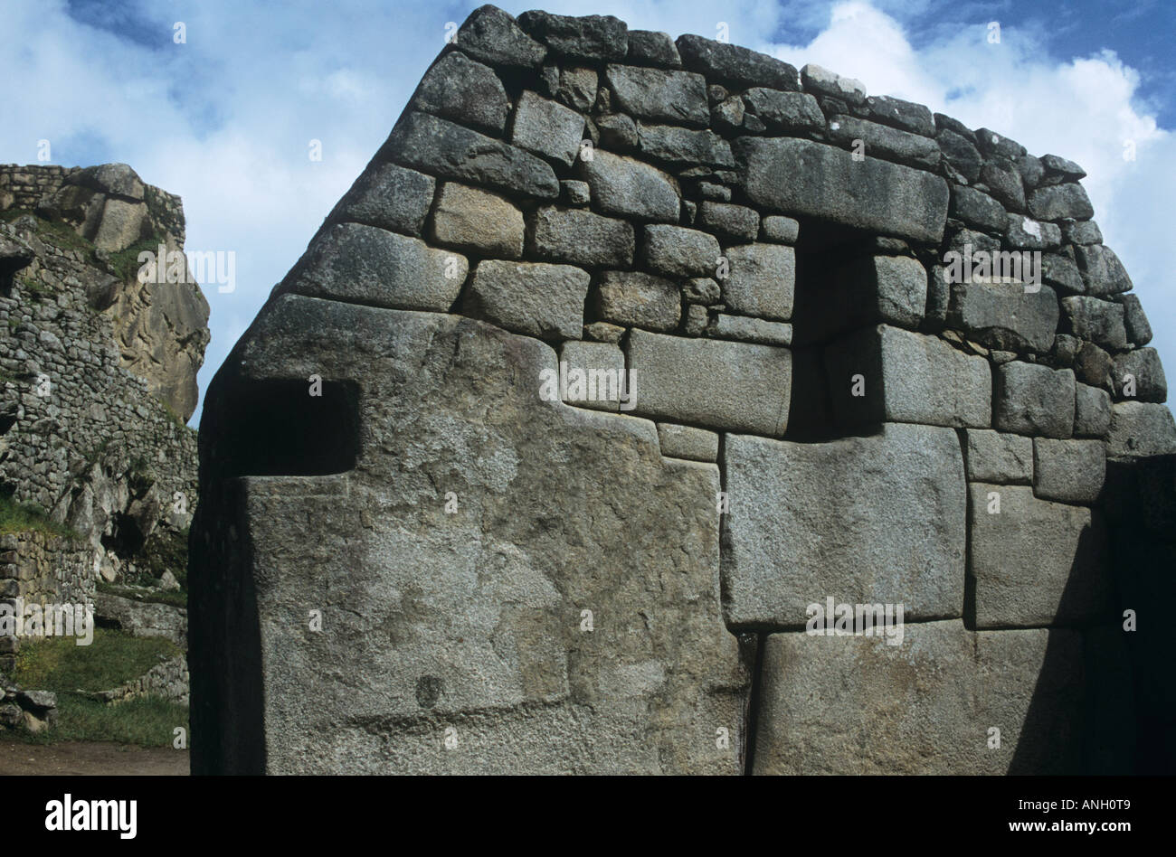 In the sacred Inca city of Machu Picchu an Inca building with a 32-sided stone is one of the sanctuary's many marvels Stock Photo