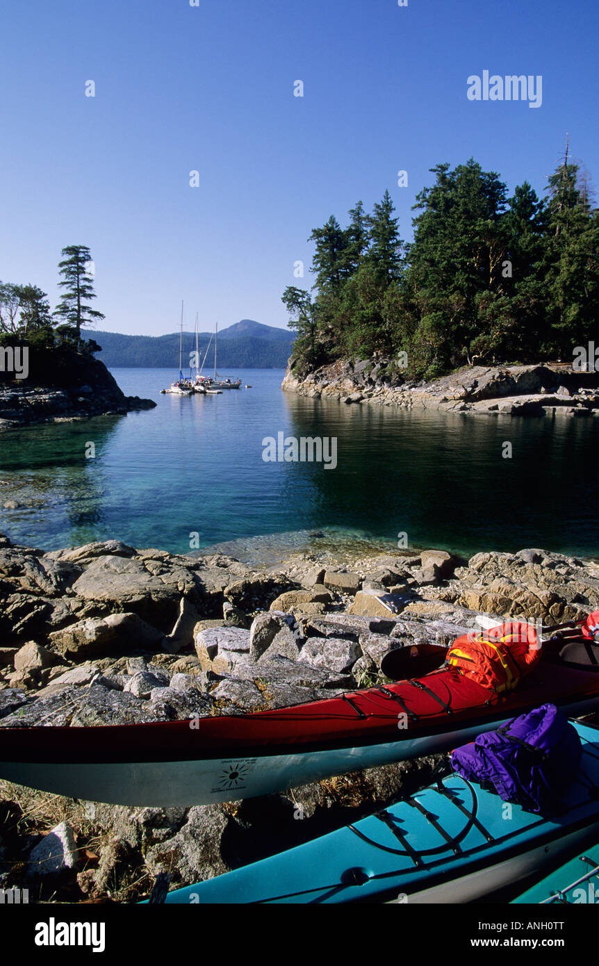 Kayaks on shore, Desolation Sound Marine Park, Curme Island, British Columbia, Canada. - Stock Image