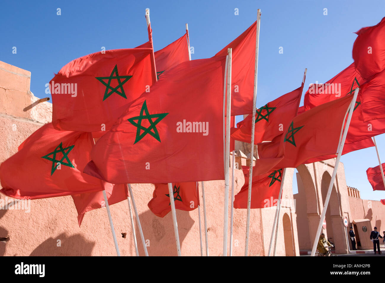 Moroccan flags flying by the city walls, Marrakesh, Morocco - Stock Image