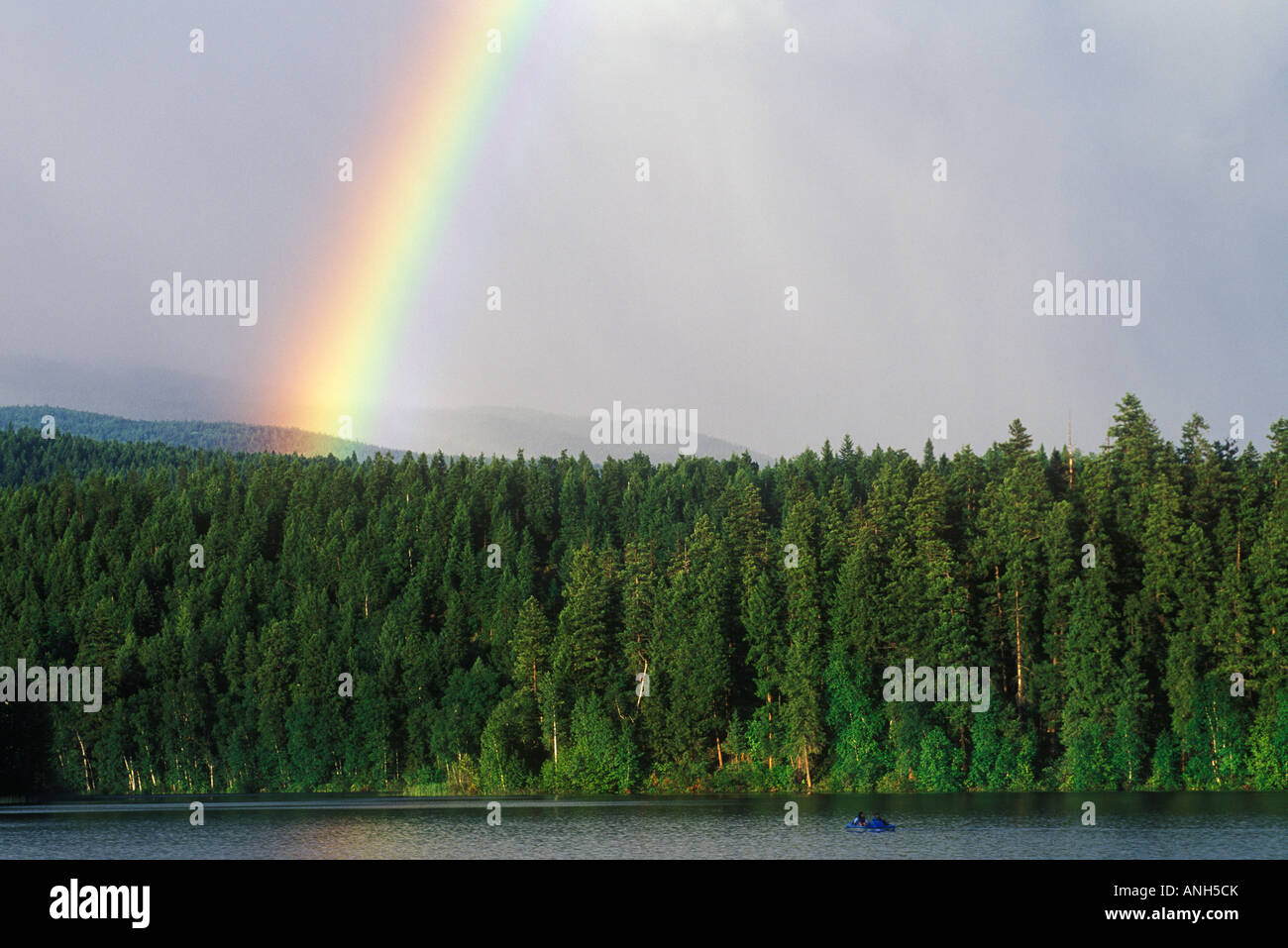 Rainbow spans across Dutch Lake, Clearwater, British Columbia, Canada. - Stock Image