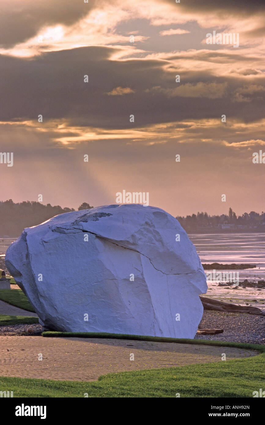 The 486-ton glacial erratic boulder for which this beach town is named, White Rock, British Columbia, Canada. - Stock Image