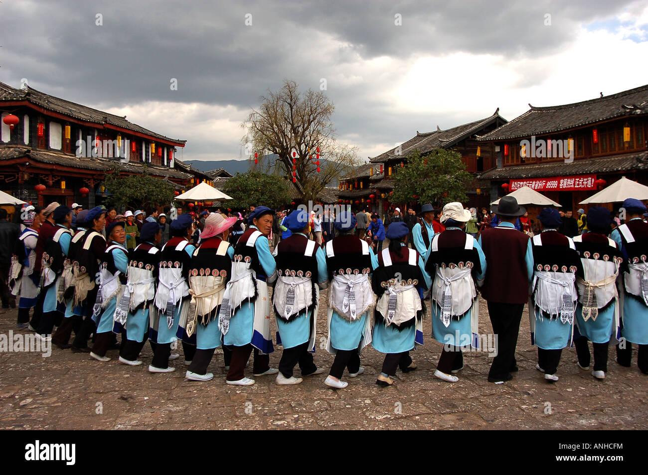 dancing women in Lijiang,Yunnan province - Stock Image