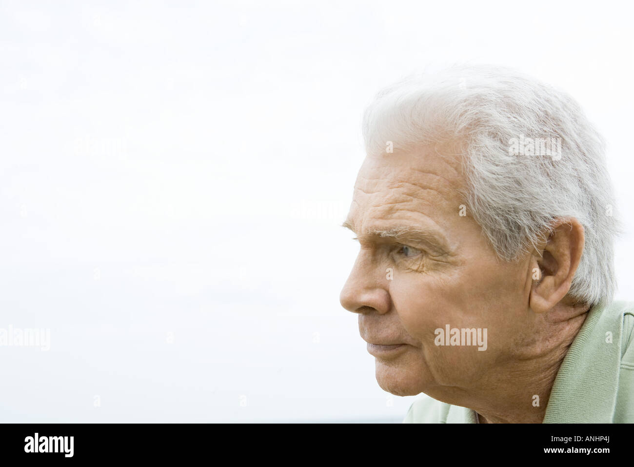 Senior man looking away, profile - Stock Image