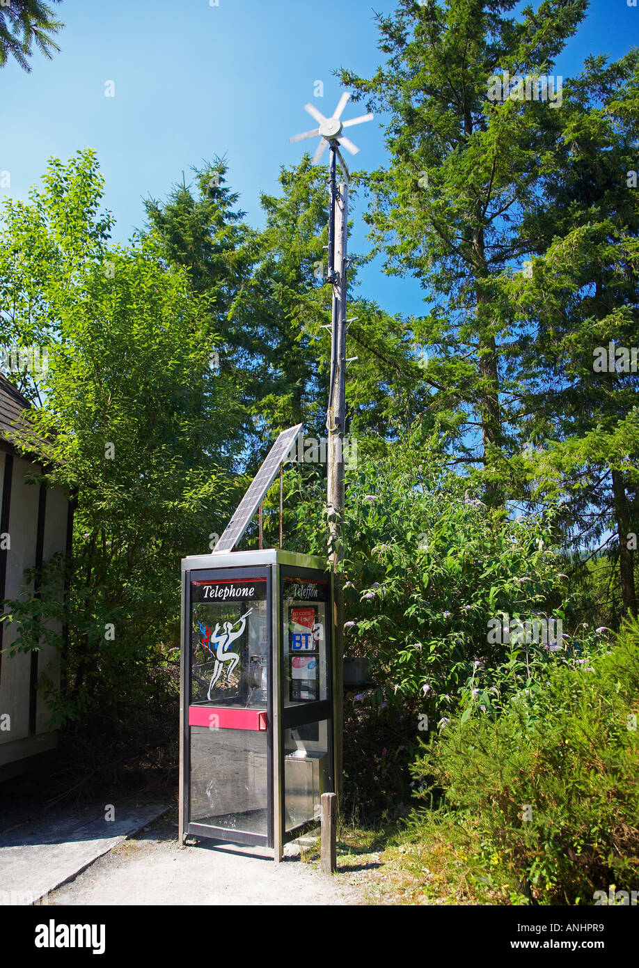 Wind Turbine and Solar Panels Powering a Telephone Kiosk at the Centre for Alternative Technology in Machynlleth, Mid Wales, UK - Stock Image