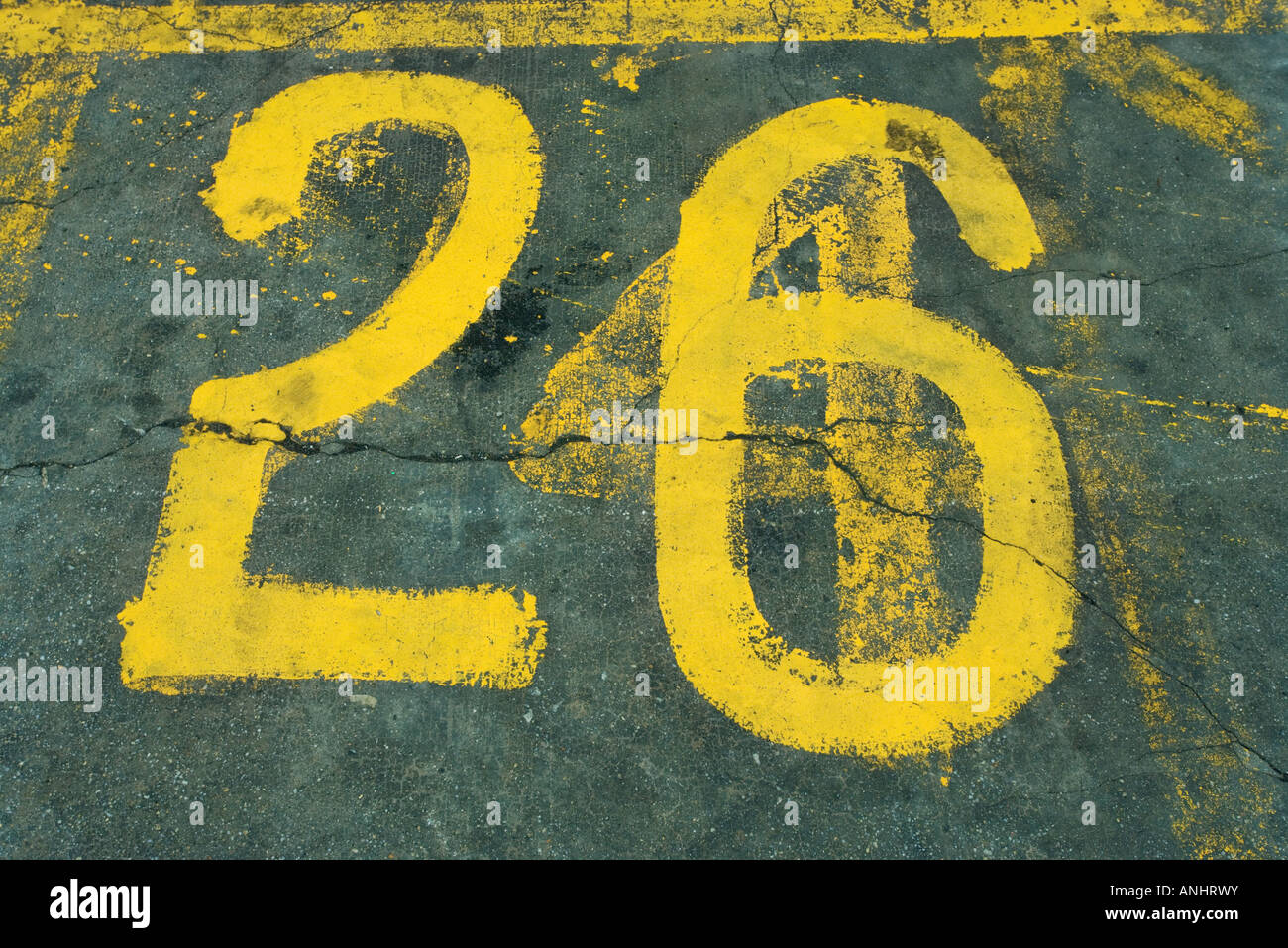 Number 26 painted on asphalt - Stock Image