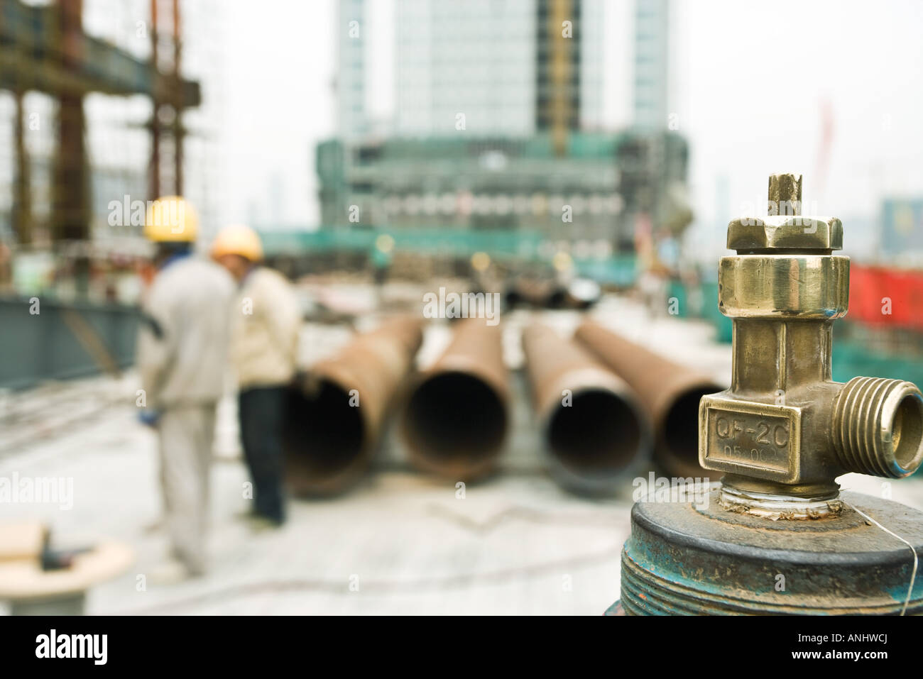Construction site, focus on spigot in foreground - Stock Image