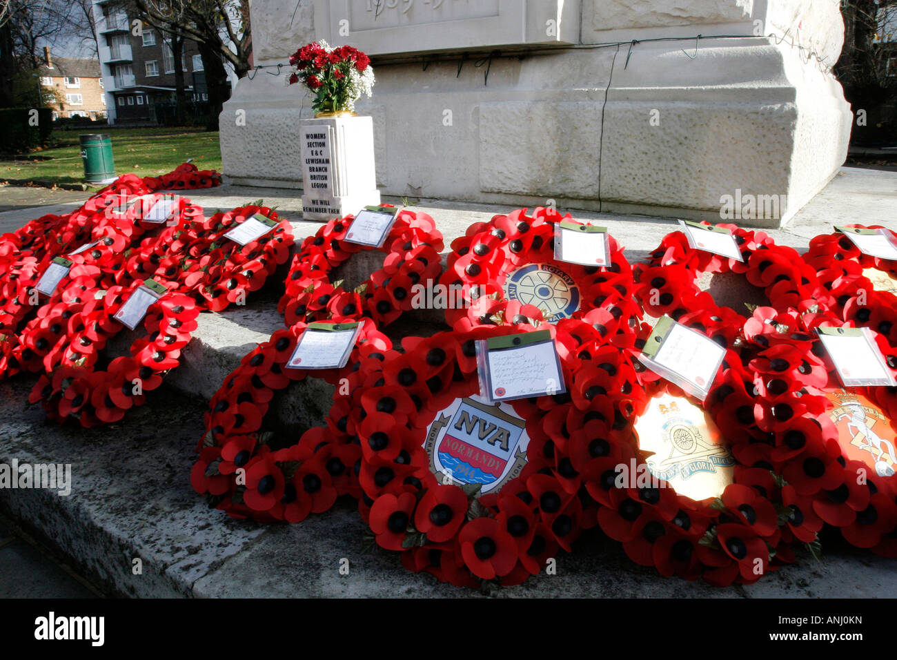 Tributes left at the Lewisham Cenotaph, SE London, after the 2007 Remembrance Day services. - Stock Image