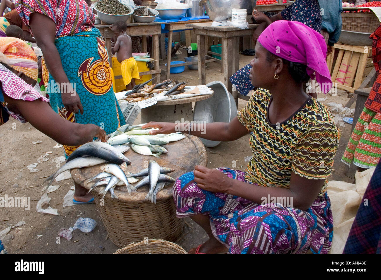 Market woman in a small fishing market in the fishing quarter of Winneba Ghana - Stock Image