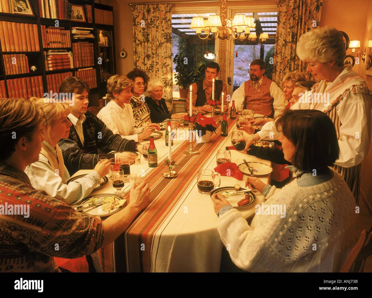 family sharing christmas dinner in sweden stock photo
