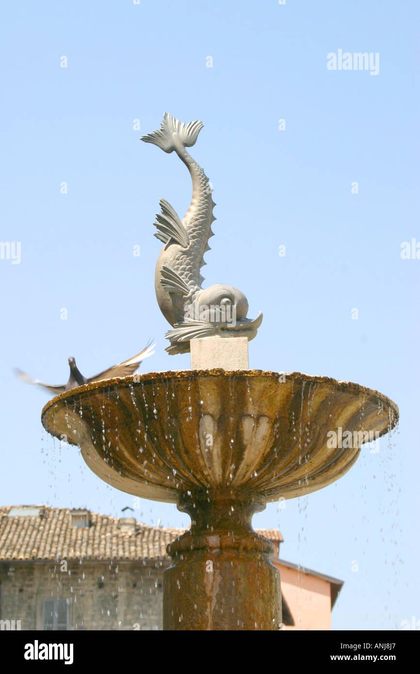 Charming dolphin fountain in piazza in Ascoli Piceno ,Le Marche, Italy Stock Photo