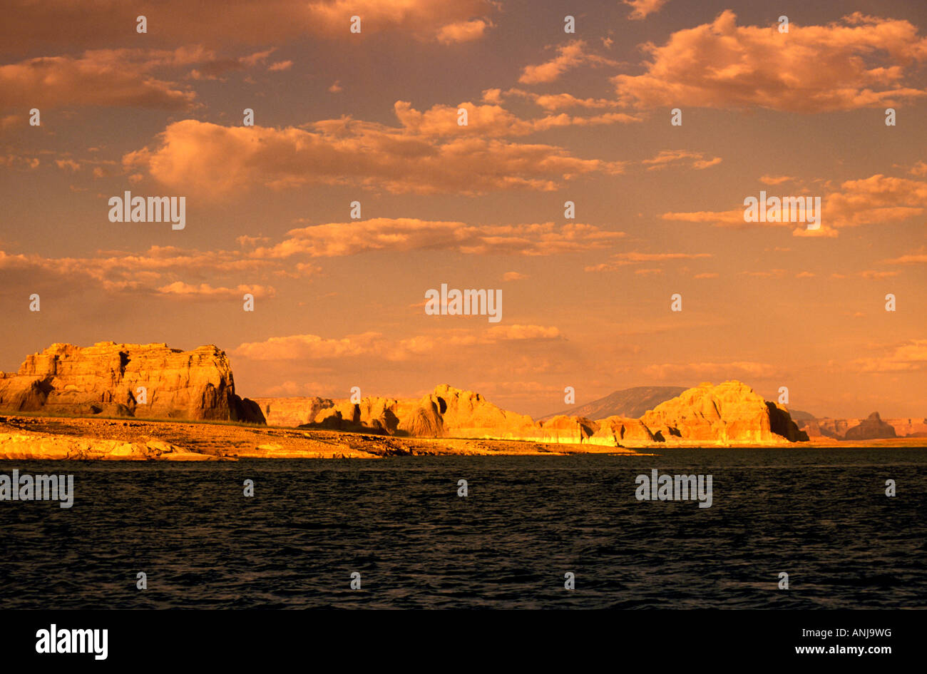 AZ Arizona Lake Powell near Grand Canyon National Park scenic sunset Utah border in background mountains clouds - Stock Image