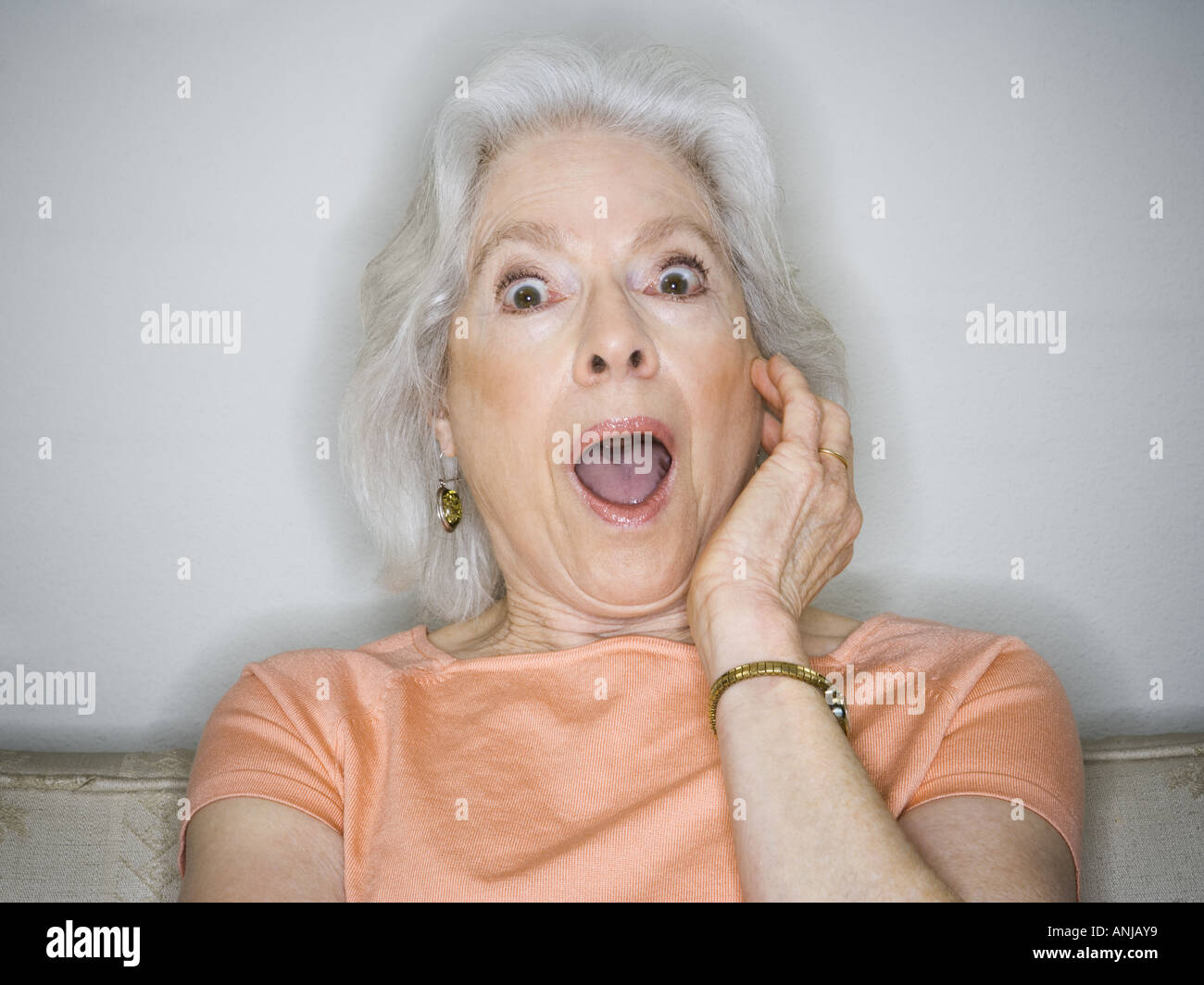 Close-up of a horrified senior woman with her mouth open